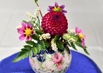 Miniature Dahlia Mixed With Other Flowers and Leaves